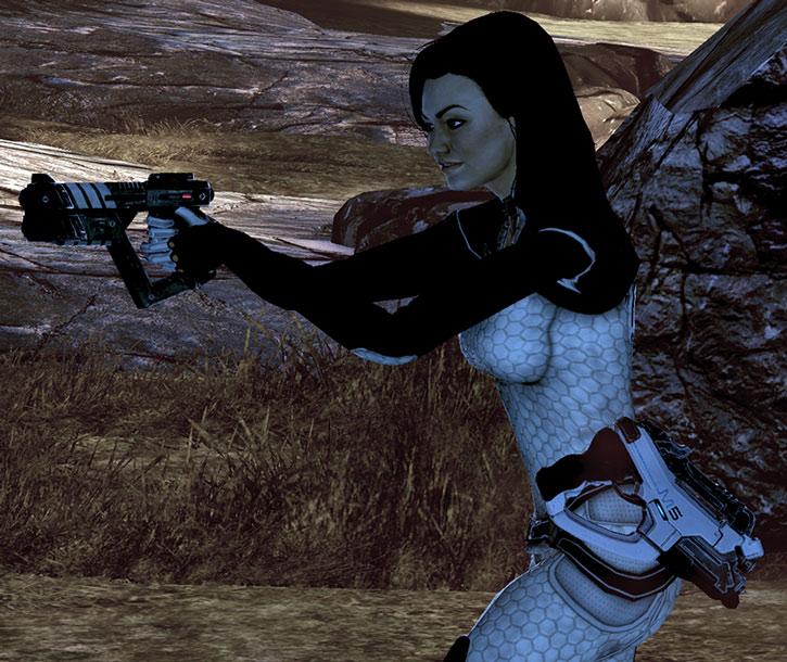 Miranda Lawson aims a Shuriken machine pistol
