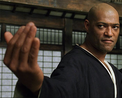 """Morpheus (Laurence Fishburne) doing a """"come hither"""" gesture"""