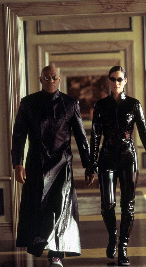 Morpheus (Laurence Fishburne) and Trinity walking down a corridor