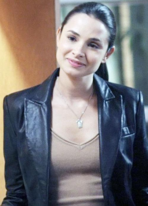 Nadia Santos (Mia Maestro in Alias) smiling in a black leather jacket