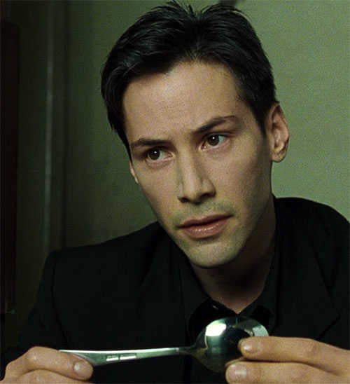 Neo (Keanu Reeves) with a spoon