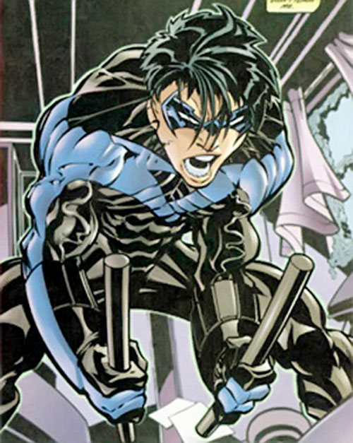 Nightwing with paired fighting sticks