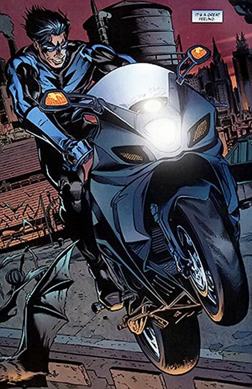 Nightwing doing motorcycle stunts