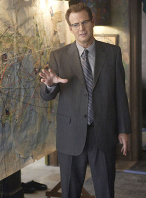 Mister Bennet (Jack Coleman in NBC's Heroes) next to a map with pins