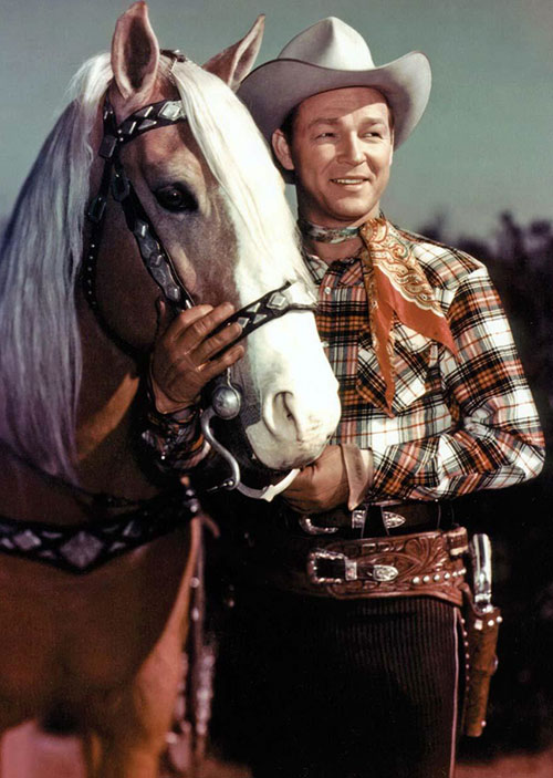Roy Rogers as a cowboy, with a horse
