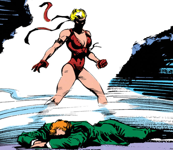Pagan (Marian Mercer) stands over a prone man