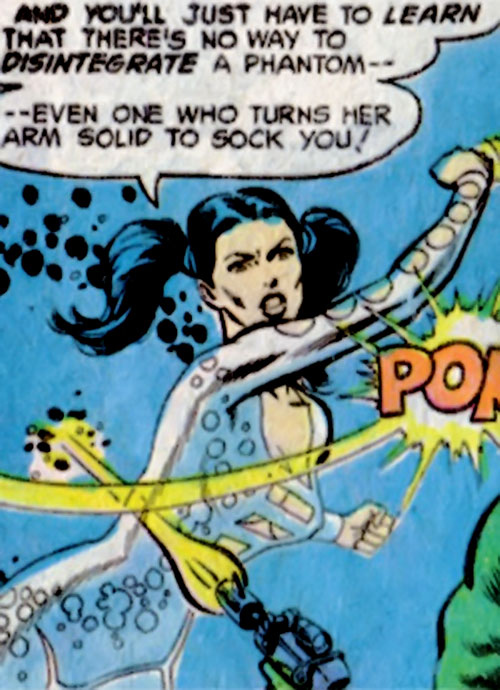 Phantom Girl of the Legion of Super-Heroes (DC Comics) punches a gunman
