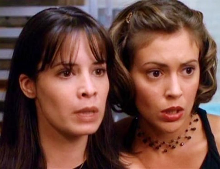 Phoebe Halliwell (Alyssa Milano) and Piper stand aghast