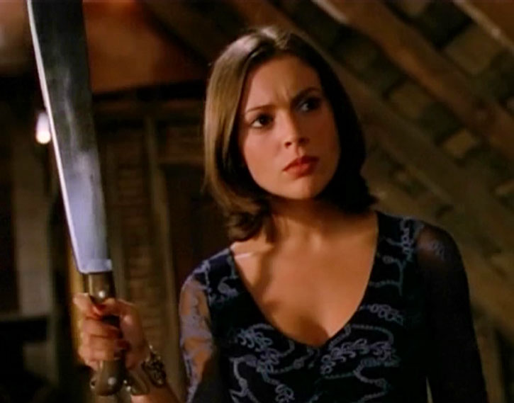 Phoebe Halliwell (Alyssa Milano) brandishing a machete