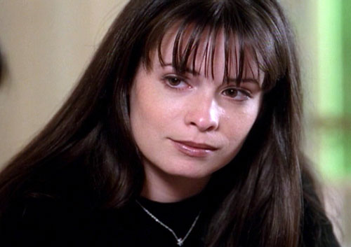 Piper Halliwell (Holy Marie Combs in Charmed) face closeup black sweater