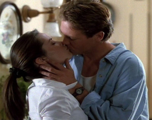 Piper Halliwell (Holy Marie Combs in Charmed) kissing a guy