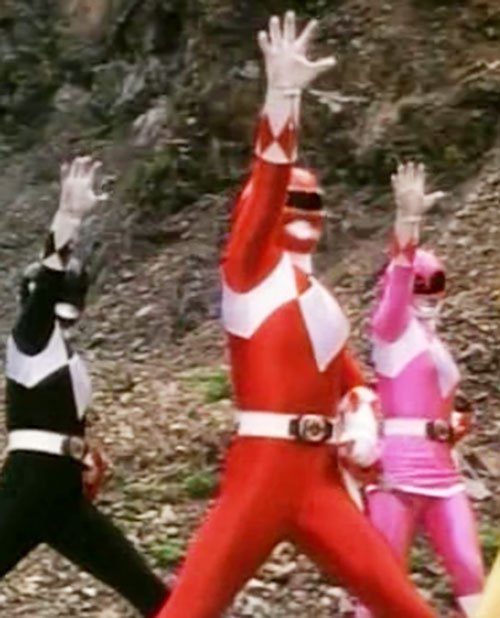 Mighty Morphin' Power Rangers team posing to summon Dynazord power