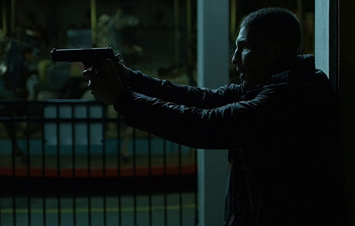Punisher (Jon Bernthal in Netflix's Daredevil season #2) pointing a .45 in the night