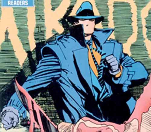 The Question (Vic Sage) (DC Comics) facing a man with a bloody knife
