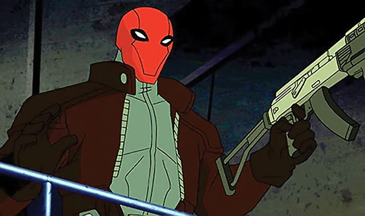 The Red Hood (Jason Todd) with an assault rifle