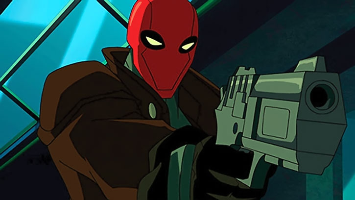 The Red Hood (Jason Todd) points a pistol