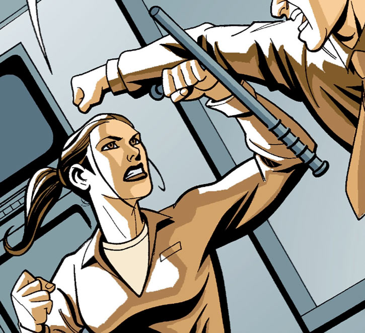 Renee Montoya fighting a prison guard with a tonfa