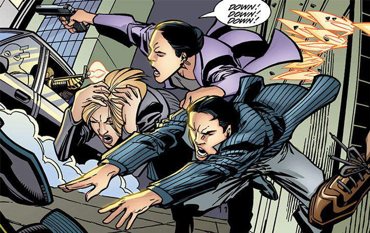 Renee Montoya saves Bruce Wayne