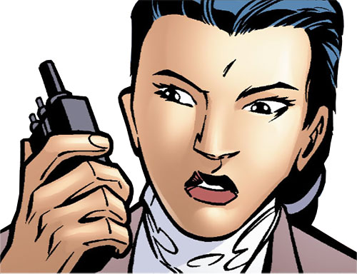 Renee Montoya - early (Batman ally) (DC Comics) with a hand held radio