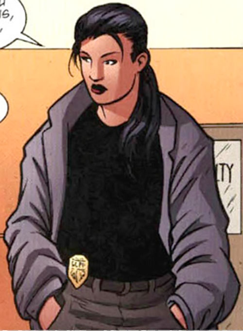 Renee Montoya (Batman ally) (DC Comics) during the early 2000s - with coat and belt badge