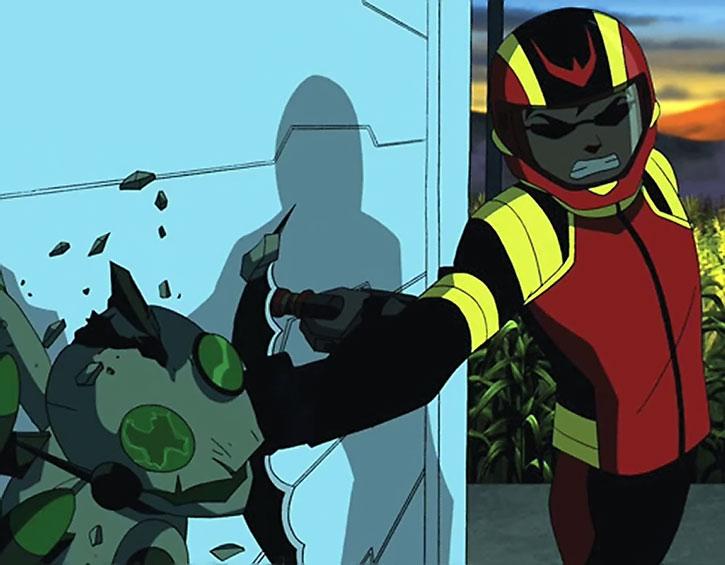 A helmeted Robin hits a creature with a batarang