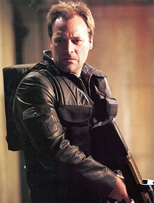 Rodney McKay (David Hewlett in Stargate Atlantis) with a black leather jacket and a gun