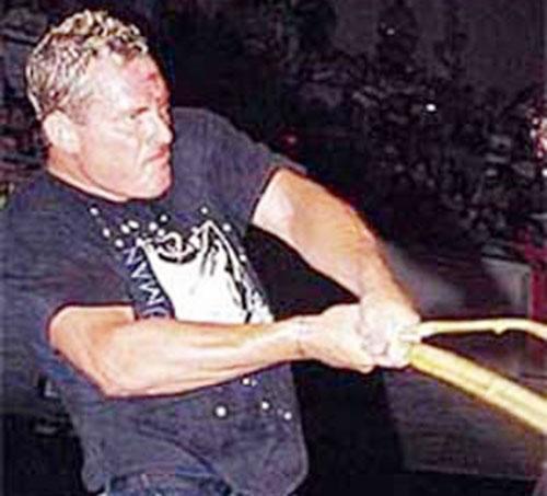Sandman (wrestler) with his Singapore cane