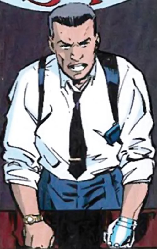 Sarge Steel (DC Comics) with fists on his desk