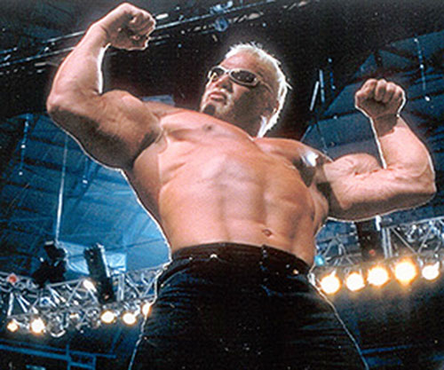 Scott Steiner flexing in a low angle shot