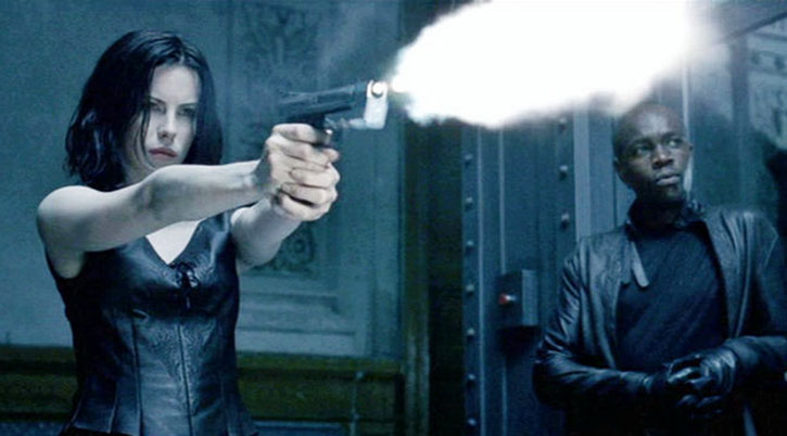Selene (Kate Beckinsale) firing a pistol at the range