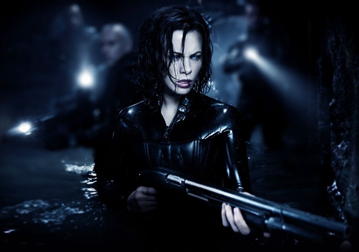 Selene (Kate Beckinsale) in water with a shotgun