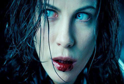 Selene (Kate Beckinsale in Underworld movies) with blood in her mouth and pale eyes
