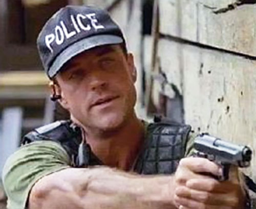 Richard Burgi (The Sentinel) with police pistol and hat