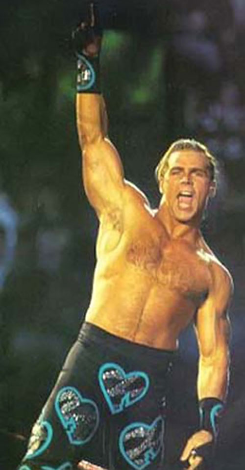 Shawn Michaels the Heartbreak Kid steps into the ring