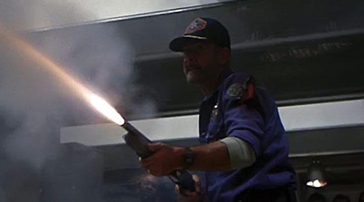 Sheriff O'Neil (Sean Connery) fires a shotgun