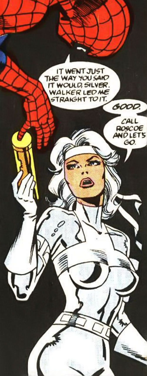 Silver Sable (Marvel Comics) (Early) hands something over to Spider-Man