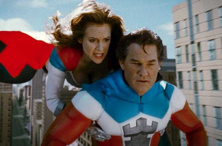 Jetstream (Kelly Preston) carrying the Commander (Kurt Russell) in flight