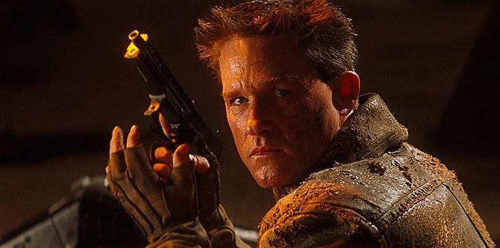 Sergeant Todd 3465 (Kurt Russell) reloads his pistol ; face closeup