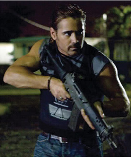 Sonny Crockett (Colin Farrell in Miami Vice) with an assault rifle and vest