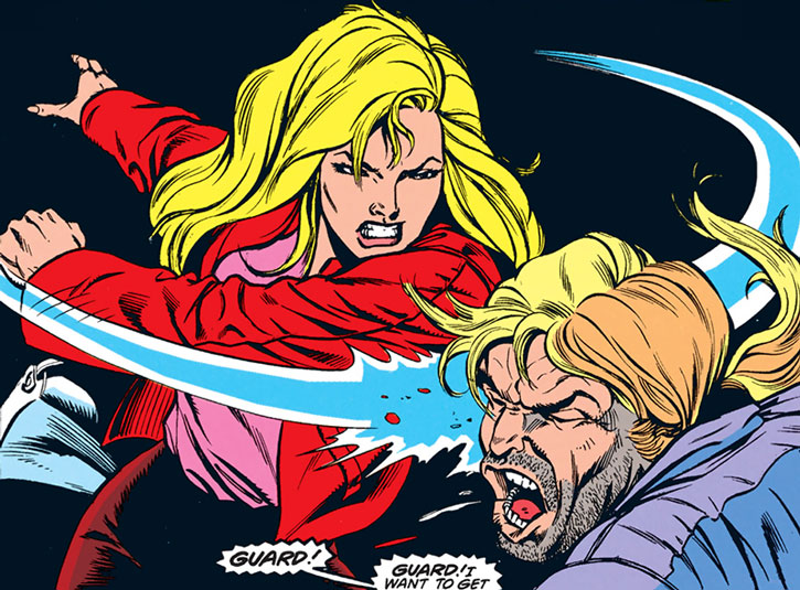 Spoiler (Stephanie Brown) in her civvies punching her father the Cluemaster