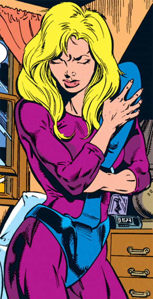 Spoiler (Stephanie Brown) putting on her costume
