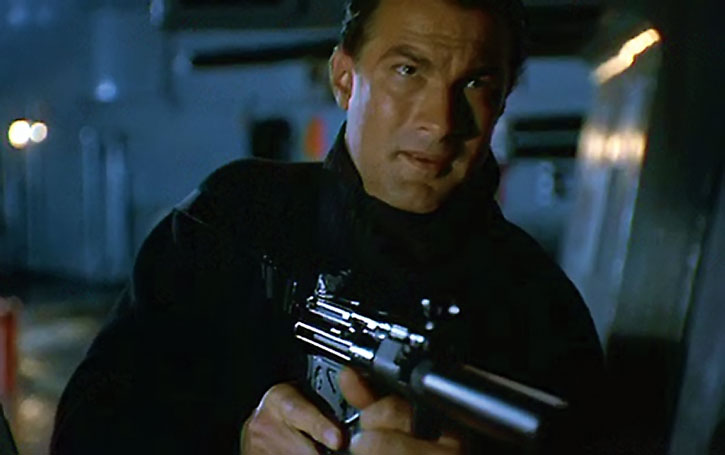 Steven Seagal at night with a silenced MP5 submachinegun