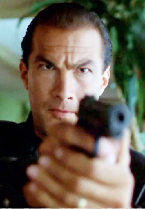 Steven Seagal pointing a pistol