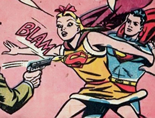 Supergirl (Queen Lucy of Borgonia) (DC Comics) protects Superboy