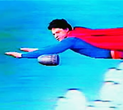 Superman (David Wilson in Superman The Musical) racing a bullet