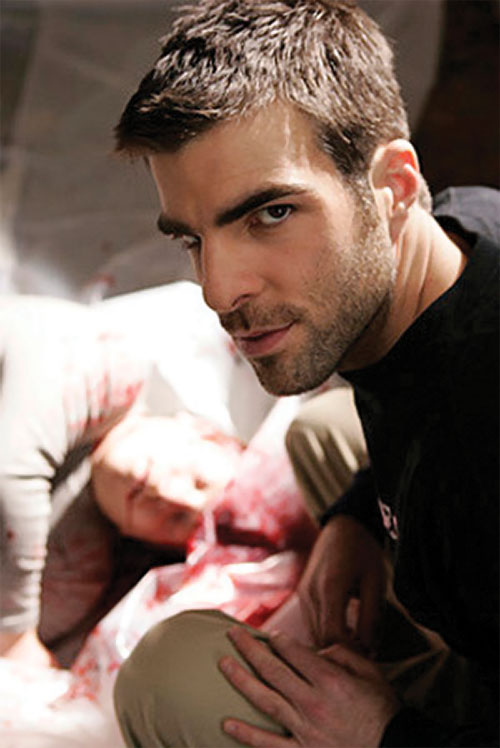 Sylar (Zachary Quinto in NBC's Heroes) over a mutilated corpse