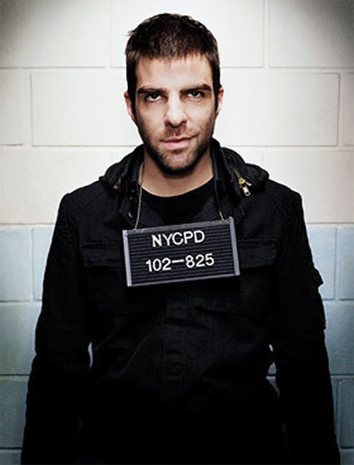 Sylar (Zachary Quinto in NBC's Heroes) smiling with a police ID plate