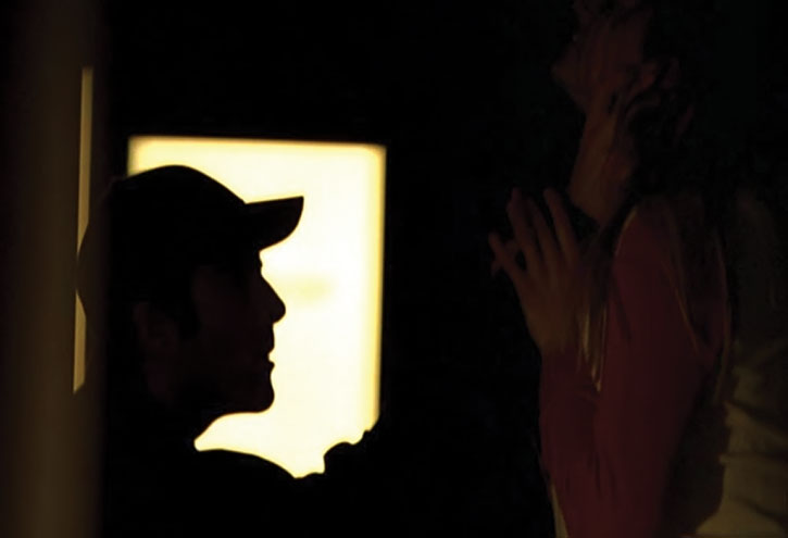 Sylar (Zachary Quinto) silhouetted while attacking the cheerleader