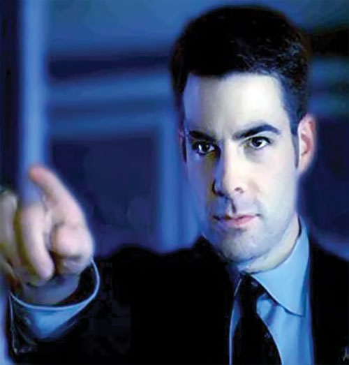 Sylar (Zachary Quinto in NBC's Heroes) in a black suit, pointing