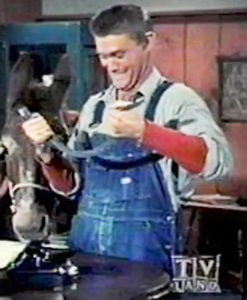 Sylvester Superman (Chuck Connors in Adventures of Superman) bending steel